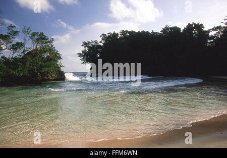 beach at Frenchman's Cove near Port Antonio on Caribbean tropical island of Jamaica - Stock Photo