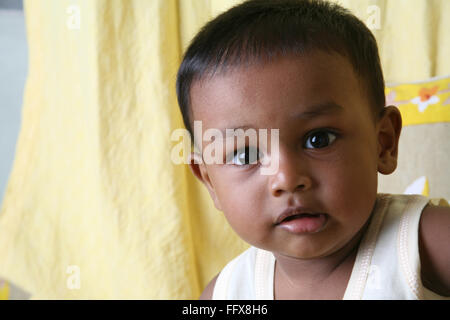 South Asian Indian small boy of 1 year looking at camera MR#642 - Stock Photo