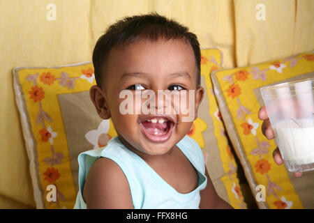 South Asian Indian small boy of 1 year laughing MR#642 - Stock Photo