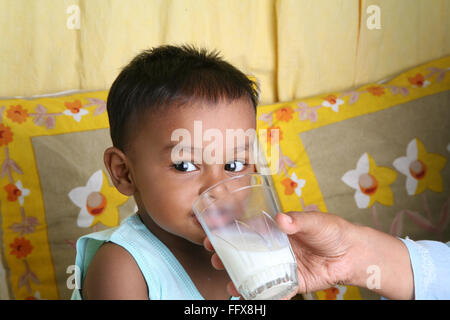 South Asian Indian small boy of 1 year drinking milk MR#642 - Stock Photo