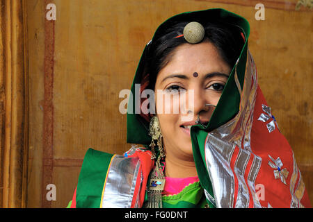 Lady in colourful traditional dress and ornament ; Jaisalmer ; Rajasthan ; India MR#772C - Stock Photo