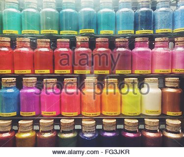 Full Frame Shot Of Colorful Powder Paint Bottles On Display In Store - Stock Photo