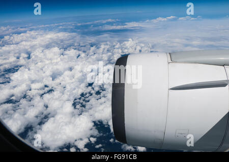 View Of Cloudscape And Vehicle Part Seen Through Airplane Window - Stock Photo