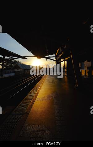 Empty Railroad Station During Sunset - Stock Photo