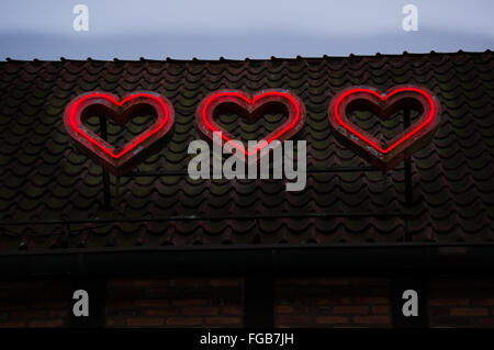 Low Angle View Of Heart Shape Neon Light - Stock Photo