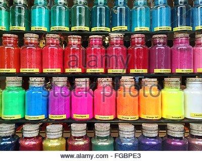 Full Frame Shot Of Colorful Paint Bottles Arranged On Shelf - Stock Photo