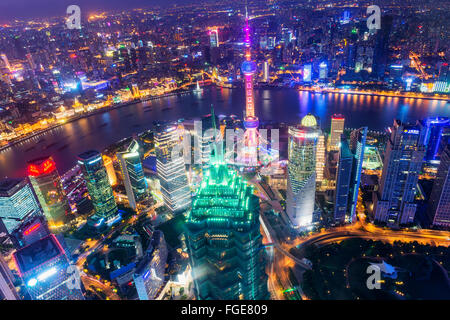 View over Pudong financial district at night, Shanghai, China - Stock Photo