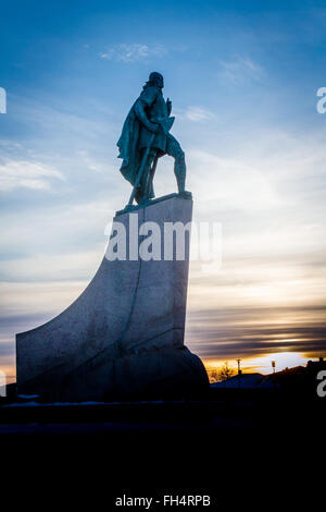 Statue of Leif Eriksen who discovered America outside the Hallgrimskirka Church in Reykjavik, Iceland at sunset - Stock Photo