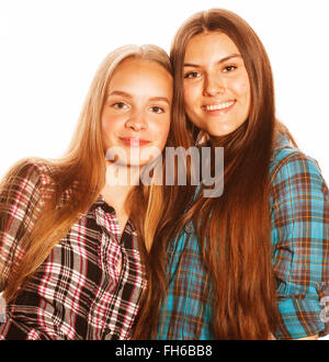 two cute teenagers having fun together isolated on white - Stock Photo