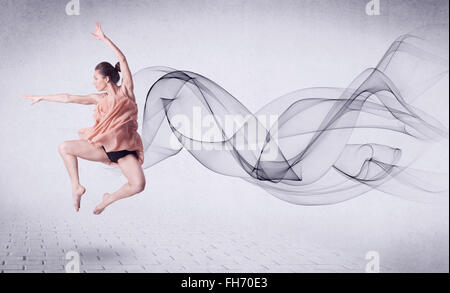 Modern ballet dancer performing with abstract swirl - Stock Photo
