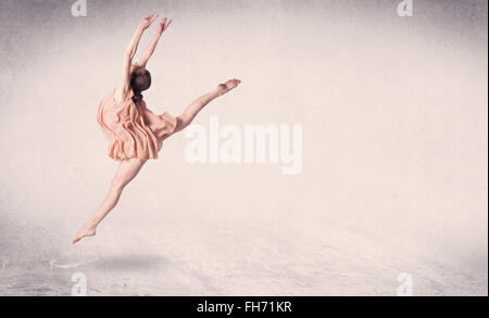Modern ballet dancer performing art jump with empty background - Stock Photo