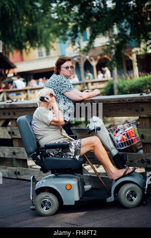 Florida usa disneyland fat person on a mobility scooter for Motorized scooter disney world