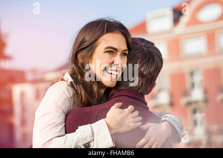 Germany, Berlin, happy young couple hugging - Stock Photo