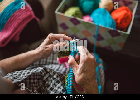 Hands of knitting senior woman, close-up - Stock Photo