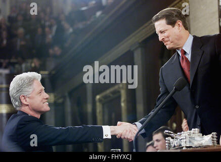 Washington, District of Columbia, USA. 27th Feb, 2016. United States President Bill Clinton is greeted by Vice President - Stock Photo