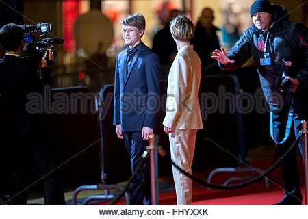 Paris, France. February 26th, 2016. FRANCE, Paris: French actors Rod Paradot (L) and et Diane Rouxel walk on the - Stock Photo