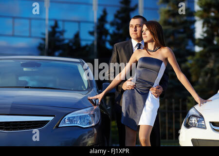young couple standing near the car - Stock Photo