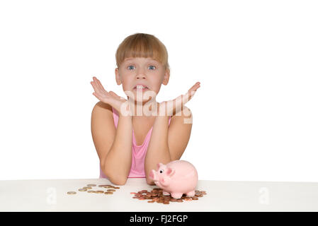 Surprised girl with piggy bank and euro coins on the table isolated - Stock Photo