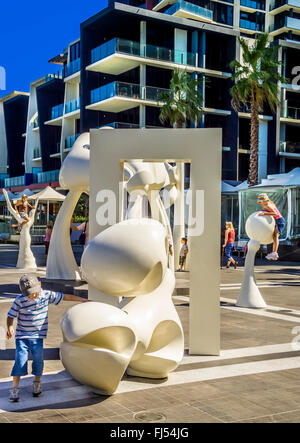 Children playing on the open air art installation 'The Silence' Docklands waterfront Melbourne Australia - Stock Photo