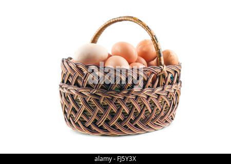 brown eggs in the basket on white - Stockfoto