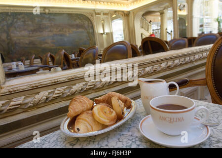 Croissants buns and hot chocolate drink at Angelina's tea room Paris France - Stock Photo