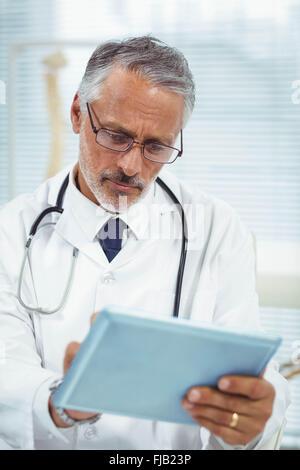 Doctor using digital tablet - Stock Photo