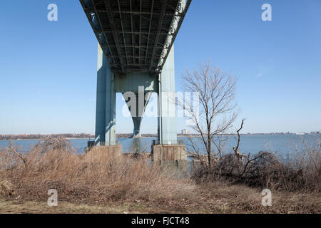 The underside of the famous Verrazano-Narrows Bridge viewed from Fort Wadsworth in Staten Island, New York. - Stock Photo