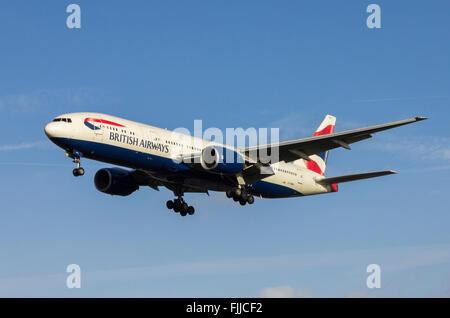 Boeing 777 British Airways Airlines landing at LHR London Heathrow Airport - Stock Photo