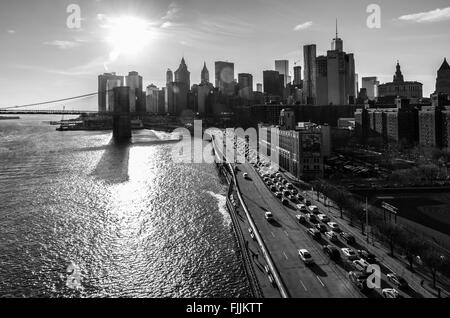 View from above the FDR drive highway in New York City with the Brooklyn Bridge, East River and downtown Manhattan - Stock Photo