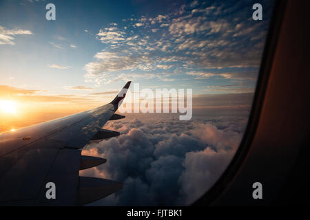 Scenic View Of Cloudscape Seen From Airplane Window - Stock Photo
