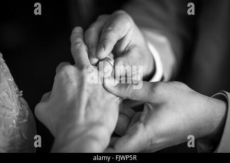Midsection Of Man Wearing Ring With Woman - Stock Photo