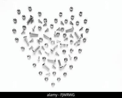 Heart Made Of Nuts And Bolts Against White Background - Stock Photo
