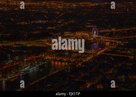 High Angle View Of Illuminated Cityscape Seen From Eiffel Tower - Stock Photo