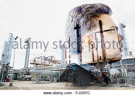 Digital composite businessman against factory - Stockfoto