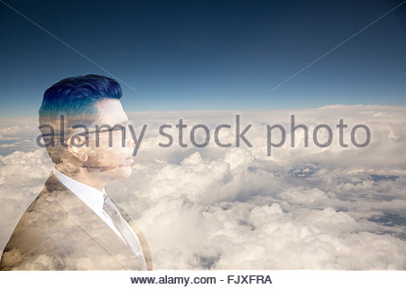 Digital composite businessman with head in clouds - Stock Photo