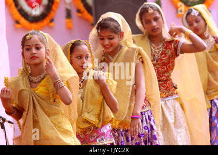 Teenage girls/children/boys are dancing with full of energy - Stock Photo