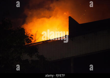 Low Angle View Of Building Under Fire At Night - Stock Photo