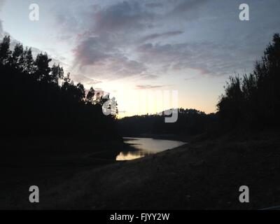 Sunset on River Zizere after Kayaking in Portugal - Stock Photo