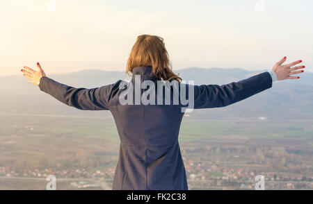 Girl on hiking trip enjoying the view from above - Stock Photo