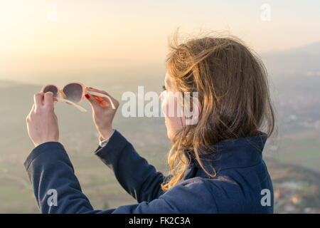 Girl on hiking trip enjoying the sunset view from above - Stock Photo