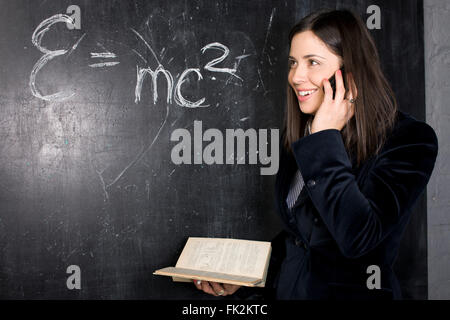 portrait of happy cute student in classroom at blackboard back to school having fun - Stock Photo