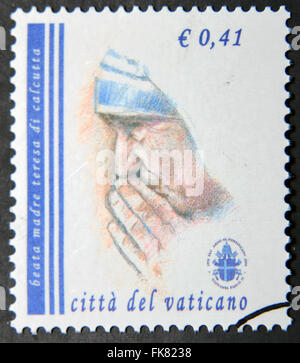 VATICAN CITY - CIRCA 2003: a stamp printed in Vatican City shows Mother Teresa, circa 2003. - Stock Photo