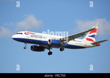 British Airways Airbus A320-200 G-EUYR landing at London Heathrow Airport - Stock Photo