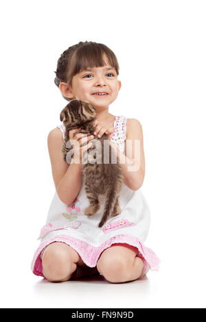 happy child playing with cat kitten - Stock Photo