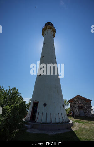 Old lighthouse in the summer. Kihnu, small island in Estonia. Europe - Stock Photo