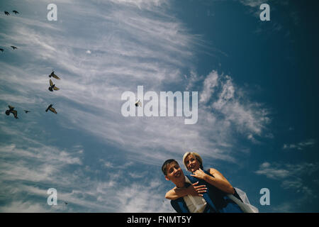 bride and groom  on the background of sky - Stock Photo