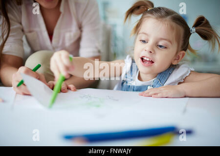 Cute little girl drawing a picture - Stock Photo