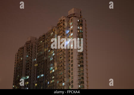 A view from below of apartment blocks in Shanghai, the building is called Moganshan Lu. - Stock Photo