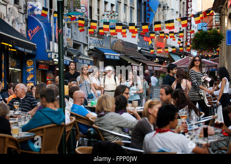 Several restaurants at Rue du Marche aux Fromages, Brussels, Belgium. In the center of Brussels abound terraces - Stock Photo