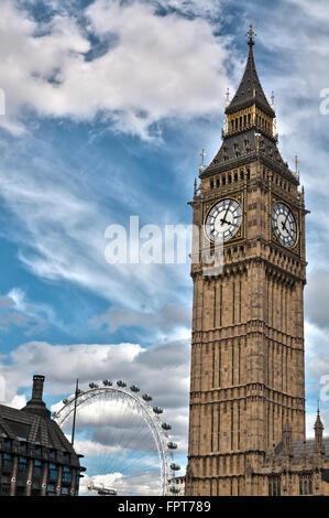 Big Ben with London Eye in the background, Houses of Parliament London - Stock Photo